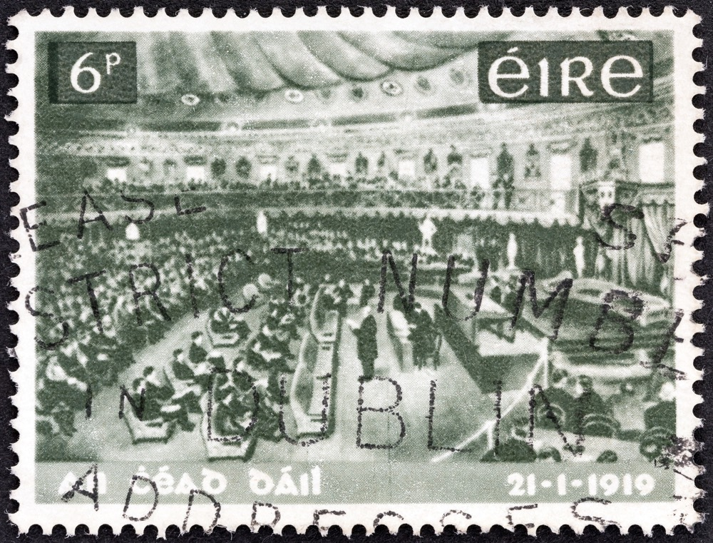 IRELAND - CIRCA 1969: A stamp printed in Ireland issued for the 50th anniversary of Dail Eireann (government) (1st National Parliament) shows Dail Eireann Assembly, circa 1969.