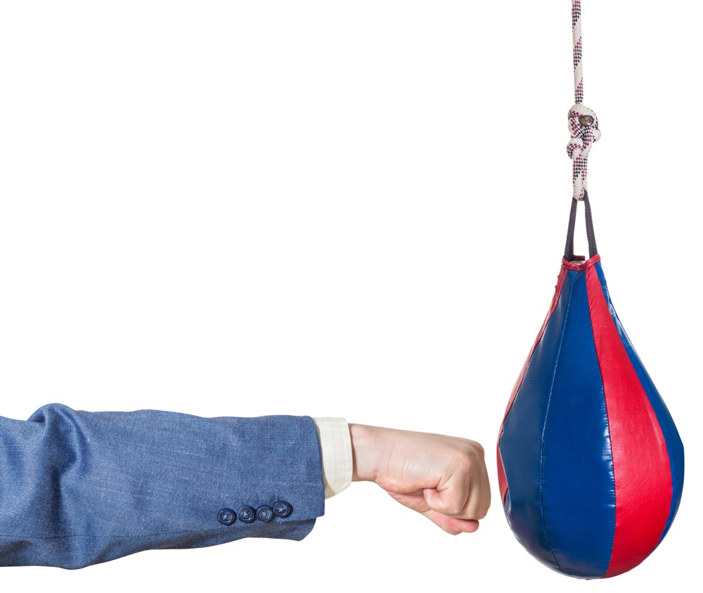 businessman punching a punch bag