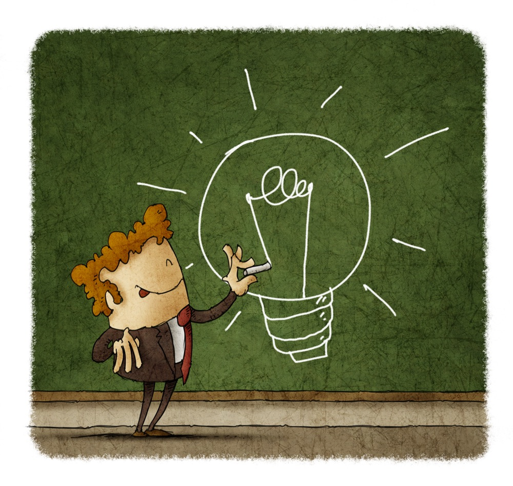 Businessman drawing a light bulb on a green chalkboard